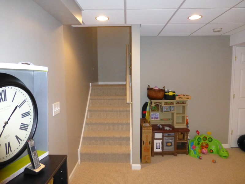 Basment Remodel with Built In Wall Shelf Cust. Lam. (6)