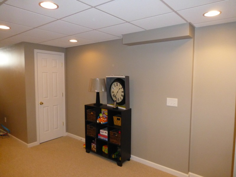 Basment Remodel with Built In Wall Shelf Cust. Lam. (7)