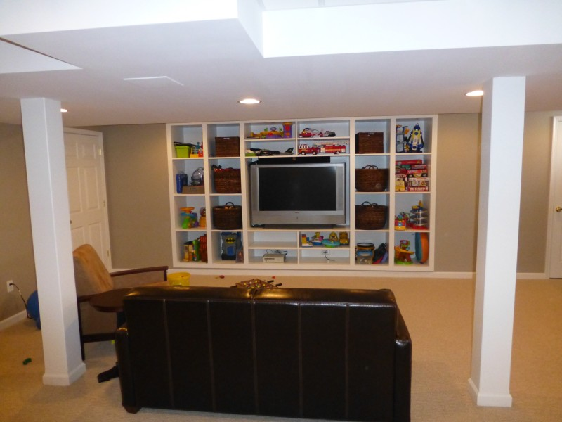 Basment Remodel with Built In Wall Shelf Cust. Lam.